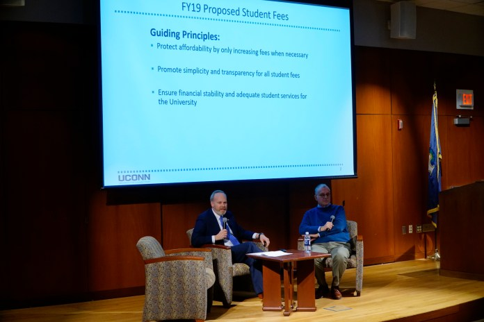 Jeremy Teitelbaum, Executive Vice President for Academic Affairs, and Scott Jordan, Executive Vice President for Administration and Chief Financial Officer, address the changes in the new UConn Fee Budget and the questions that UConn students have in an Open Forum Presentation. (Eric Wang/The Daily Campus)