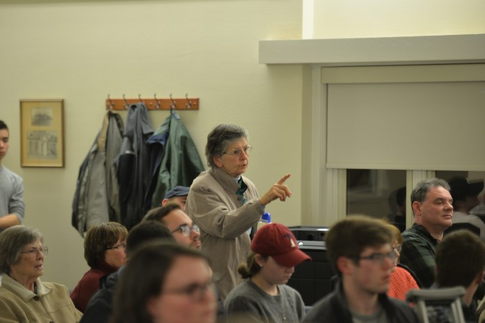 Mansfield resident Betty Wassmundt interrupts Mayor Paul Shapiro during debate on whether or not to elect Ric Hossack on Tuesday, Feb. 13, 2018. (Amar Batra/The Daily Campus)
