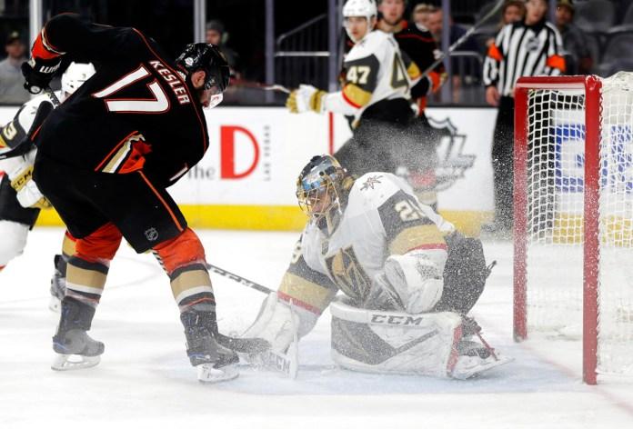 Vegas Golden Knights goalie Marc-Andre Fleury stops a shot from Anaheim Ducks center Ryan Kesleduring the third period of an NHL hockey game Monday, Feb. 19, 2018, in Las Vegas. Anaheim won, 2-0. (AP Photo/Isaac Brekken)