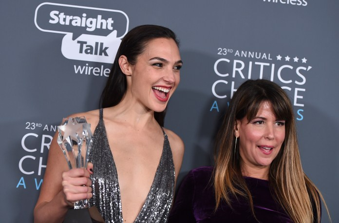 """Gal Gadot, left, and Patty Jenkins, winners of the award for best action movie for """"Wonder Woman"""", pose in the press room at the 23rd annual Critics' Choice Awards at the Barker Hangar in Santa Monica, Calif. (Photo by Jordan Strauss/Invision/AP, File)"""