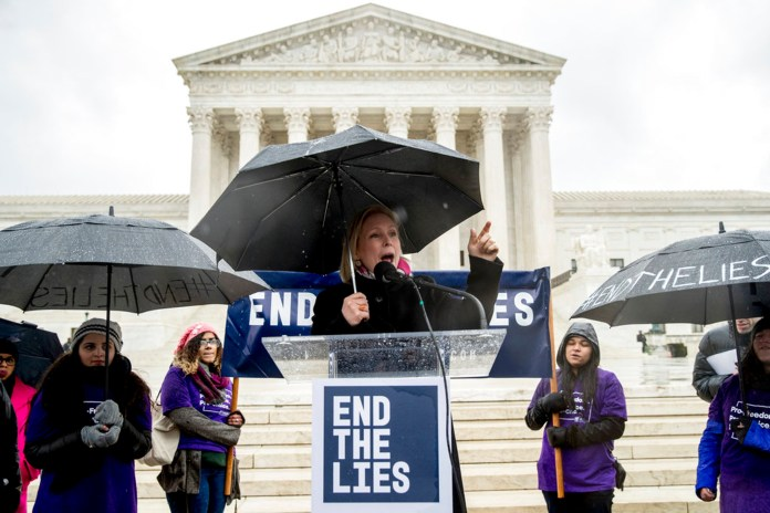 Sen. Kirsten Gillibrand, D-N.Y., center, speaks during an abortion rights rally outside the Supreme Court in Washington, Tuesday, March 20, 2018, as the Supreme Court hears arguments in a free speech fight over California's attempt to regulate anti-abortion crisis pregnancy centers. (AP Photo/Andrew Harnik)