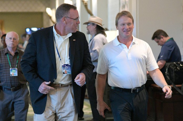 Cleveland Browns general manager John Dorsey, left, and Oakland Raiders head coach Jon Gruden chat during the NFL owners meetings, Monday, March 26, 2018 in Orlando, Fla. (Phelan M. Ebenhack/AP Images for NFL)