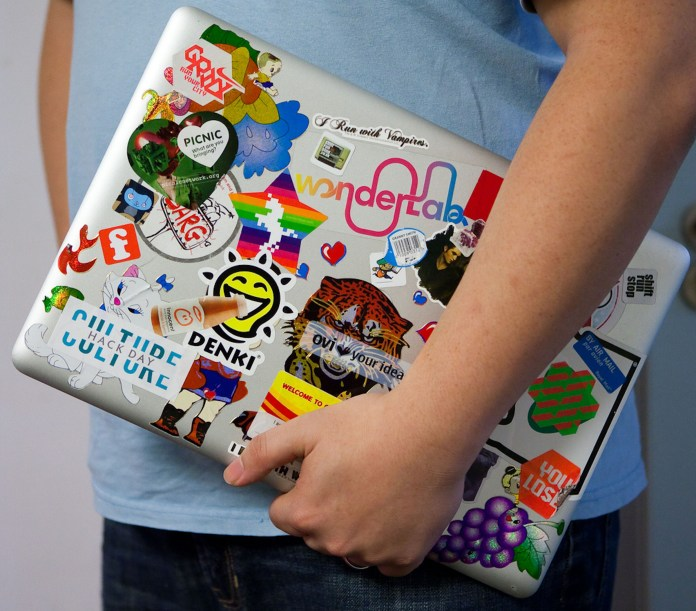 Laptop stickers, a staple in college culture, can be used to express oneself or even can become a conversation starter. (Culture Hack Day/Flickr)