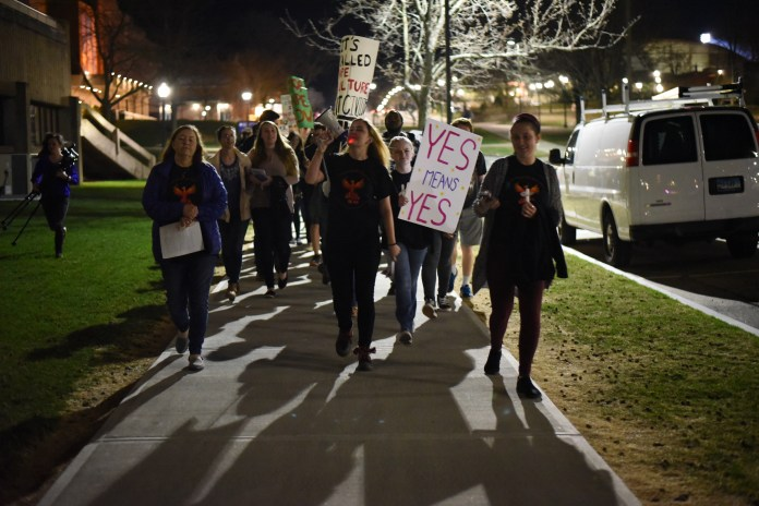 The Student Union Ballroom is full of people for Take Back the Night, an event about sexual harassment hosted by the Women's Center. A march followed the presentations. (Charlotte Lao/The Daily Campus)