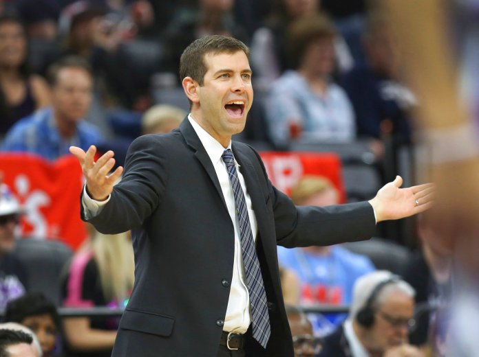 Boston Celtics head coach Brad Stevens directs his players during the first half of an NBA basketball game in Sacramento, Calif., Sunday, March 25, 2018. (AP Photo/Steve Yeater)