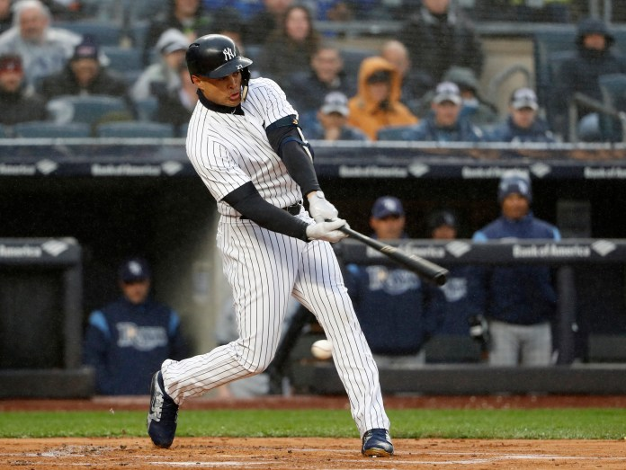 New York Yankees Giancarlo Stanton strikes out swinging in his first at-bat in the first inning of an opening day baseball game against the Tampa Bay Rays at Yankee Stadium in New York, Tuesday, April 3, 2018. (AP Photo/Kathy Willens)