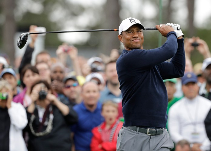 Tiger Woods hits on the first tee during a practice round for the Masters golf tournament Wednesday, April 4, 2018, in Augusta, Ga. (AP Photo/David J. Phillip)