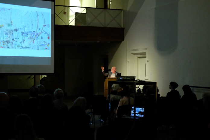 """Kevin Conley on whether the or not an artists plays a hand in the physical creation of their own art in the Benton museum on Thursday, March 5, 2018.Conley is a well known arts writer and editor and has contributed to """"The Wall Street Journal"""" and """"The New Yorker"""" among other publications. (Jon Sammis/The Daily Campus)"""