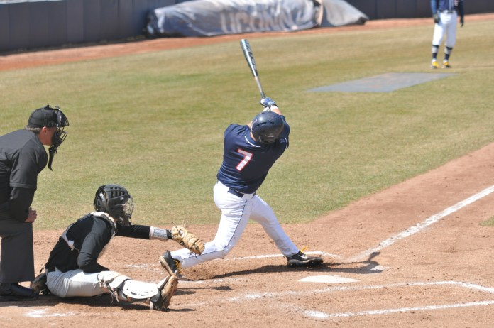 UConn took to the plate against USF on Saturday, Apr. 8 at Christian Field. The Huskies, in a double header, lost 10-8 on Saturday and won 6-2 on Sunday (Jon Sammis/The Daily Campus)