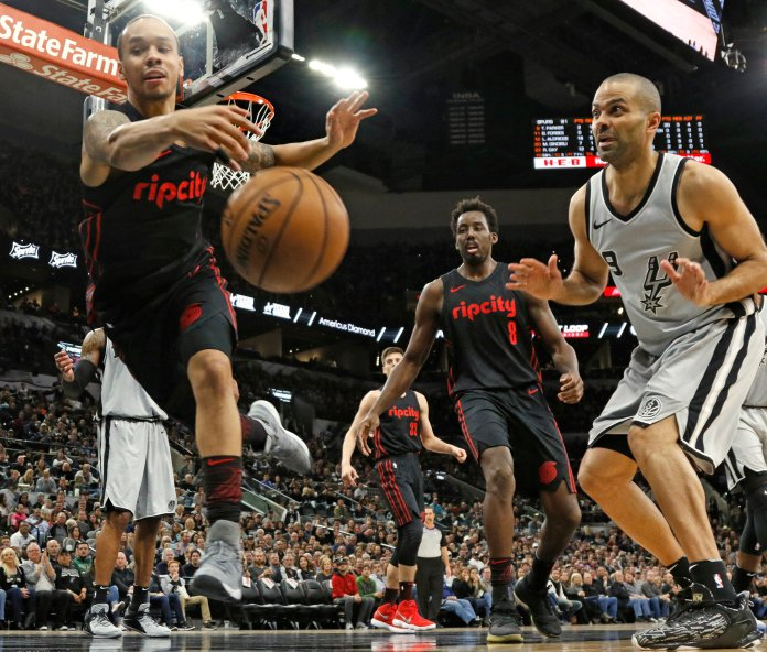 Portland Trail Blazers point guard Shabazz Napier, left, tries to make a save as San Antonio Spurs guard Tony Parker (9) watches during the second half of an NBA basketball game Saturday, April 7, 2018, in San Antonio. San Antonio won 116-105. (AP Photo/Ronald Cortes)