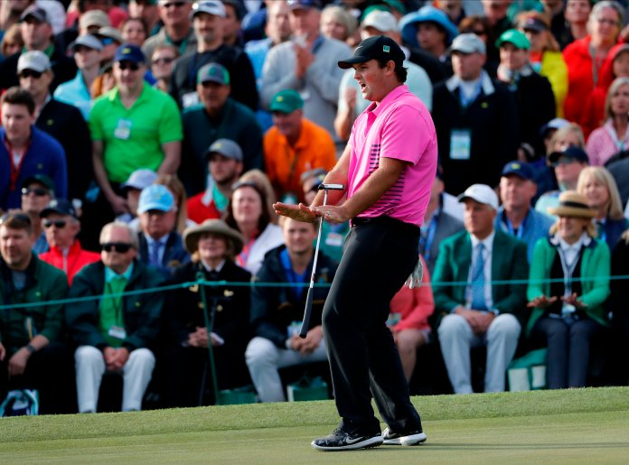 Patrick Reed reacts to a putt on the 18th hole during the fourth round at the Masters golf tournament Sunday, April 8, 2018, in Augusta, Ga. (AP Photo/David Goldman)