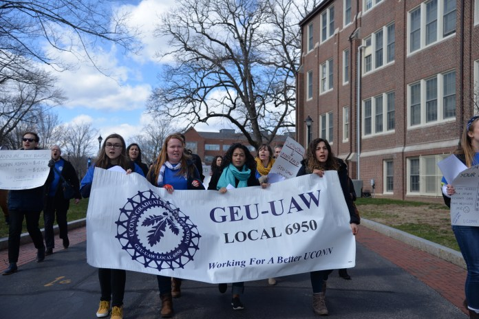 The UConn Graduate Student Union stages a sit-in in the Student Union and outside the Bursar's office to demand a fair contract on Thursday, April 5, 2018. The union wants a contract that includes affordable health benefits, fair compensation and enhanced sexual harassment protection. (Amar Batra/The Daily Campus)