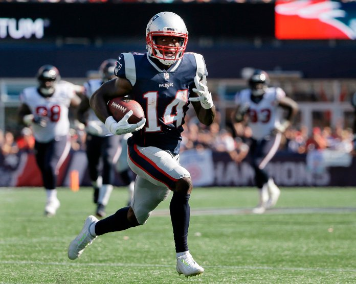 In this Sept. 24, 2017, file photo, New England Patriots wide receiver Brandin Cooks runs toward the goal line for a touchdown after catching a pass from Tom Brady during the second half of an NFL football game against the Houston Texans in Foxborough, Mass. The Patriots have traded Cooks to the Rams for Los Angeles' first-round draft pick, 23rd overall. In the deal Tuesday, April 3, 2018, New England also sends a fourth-round choice to the Rams, who give the Patriots a sixth-rounder. (AP Photo/Steven Senne, File)
