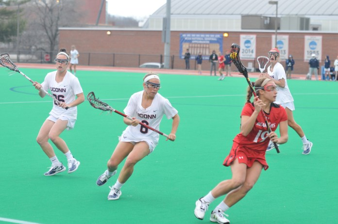 UConn's Women's Lacrosse team takes to the field against Cincinnati on Friday, Apr. 13. The Huskies played ruthlessly, dominating the Bearcats 20-8. (Jon Sammis/The Daily Campus)