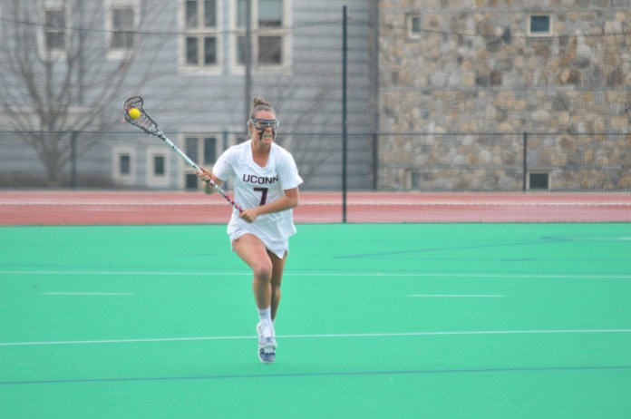 Sophomore defender Alyssa Conklin looks for an open teammate during the Huskies 20-8 victory over the Cincinnati Bearcats on Friday, April 13 at the Sherman Family Sports Complex. The Huskies lost 15-14 to No. 23 Georgetown on April 18. (Jon Sammis/The Daily Campus)