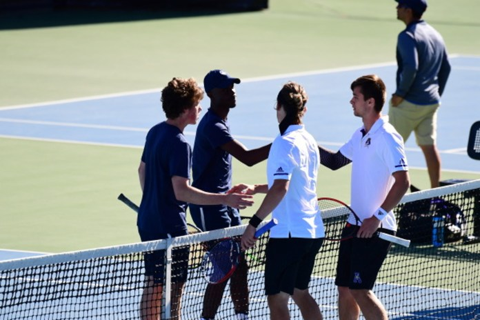 Huskies and Pirates shake hands after a doubles match (UConn Atheltics)