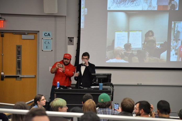"""The UConn College Republicans brought in White House correspondent Lucian Wintrich from The Gateway Pundit for a lecture titled, """"It's ok to be white."""" Schenker Hall was packed with both supporters and protesters. (Amar Batra/The Daily Campus)"""