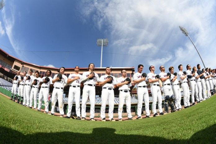 UConn Baseball stands for the National Anthem in Florida prior to a game (UConn Athletics)