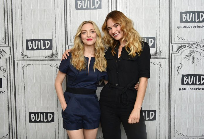 """Actors Amanda Seyfried, left, and Lily James attend a BUILD Speaker Series to promote their film """"Mamma Mia! Here We Go Again"""" at AOL Studios on Thursday, July 19, 2018, in New York. (Photo by Evan Agostini/Invision/AP)"""