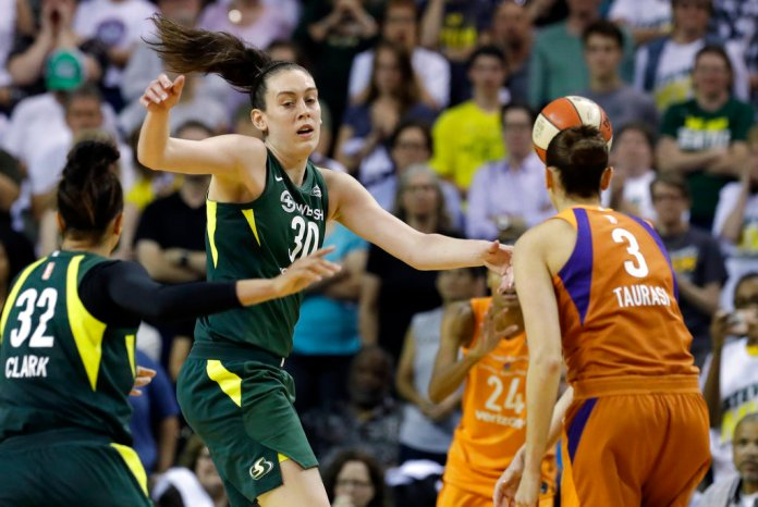Seattle Storm's Breanna Stewart (30) and Alysha Clark (32) defend as Phoenix Mercury's Diana Taurasi (3) gets off a pass in the second half in a WNBA basketball playoff semifinal, Tuesday, Aug. 28, 2018, in Seattle. The Storm won 91-87 in overtime. (AP Photo/Elaine Thompson)