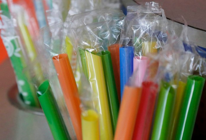 FILE - This July 17, 2018 file photo shows wrapped plastic straws at a bubble tea cafe in San Francisco. If you want a straw with your drink you may soon have to ask at California restaurants. Lawmakers in the Assembly voted 45-20 Thursday, Aug. 23, to send Gov. Jerry Brown a bill to bar full-service restaurants from giving out single-use plastic straws unless customers request them. It wouldn't ban straws as some cities have. (AP Photo/Jeff Chiu, File)