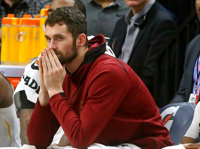 FILE - In this Jan. 8, 2018, file photo, Cleveland Cavaliers' Kevin Love watches from the bench in the second half of an NBA basketball game against the Minnesota Timberwolves in Minneapolis. (AP Photo/Jim Mone, File)