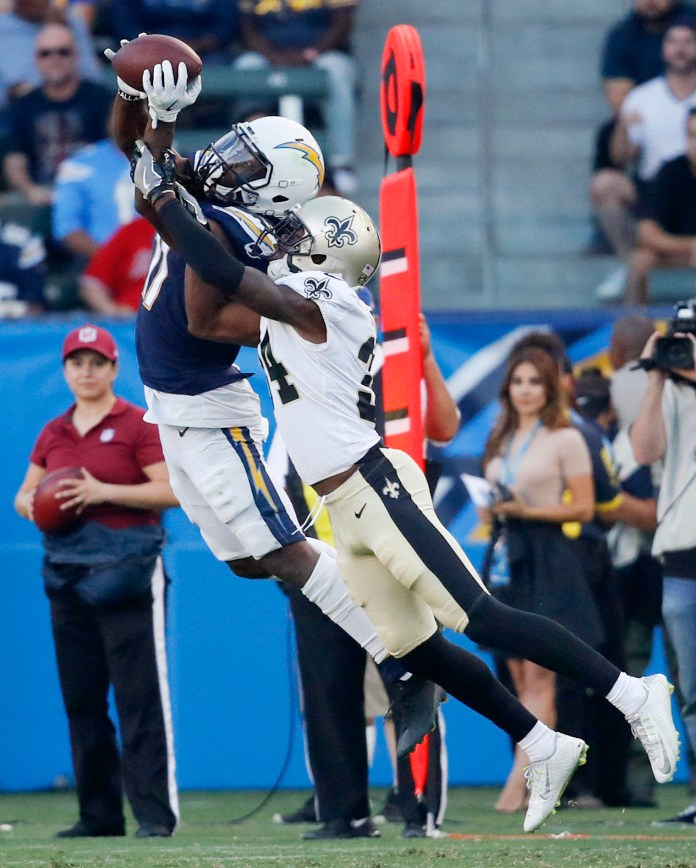 Los Angeles Chargers wide receiver Geremy Davis, hauls in a pass as Saints defensive back Vonn Bell covers during the second half of an NFL preseason football game. (AP Photo/Jae C. Hong)