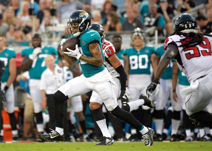 FILE - In this Aug. 25, 2018, file photo, Jacksonville Jaguars wide receiver Donte Moncrief (10) runs after catching a pass between Atlanta Falcons cornerback Isaiah Oliver (20) and linebacker De'Vondre Campbell (59) during the first half of an NFL preseason football game, in Jacksonville, Fla.