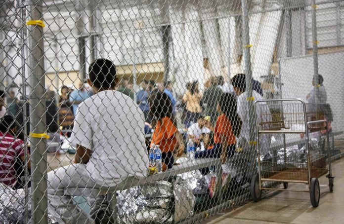 FILE - In this June 17, 2018 file photo provided by U.S. Customs and Border Protection, people who've been taken into custody related to cases of illegal entry into the United States, sit in one of the cages at a facility in McAllen, Texas. (U.S. Customs and Border Protection's Rio Grande Valley Sector via AP, File)