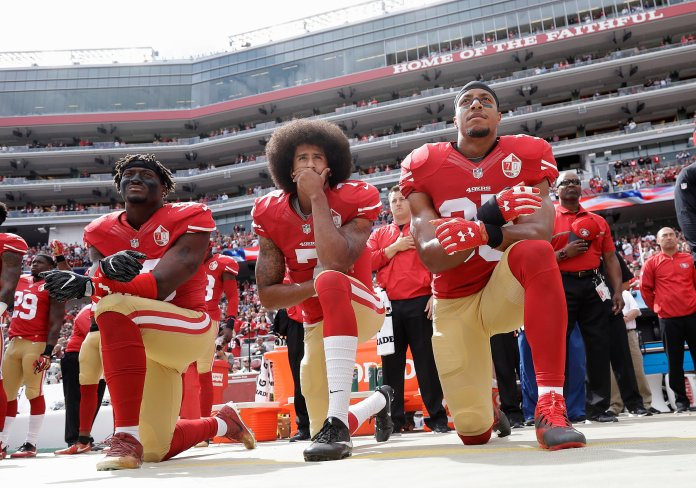 In this Oct. 2, 2016 file photo, from left, San Francisco 49ers outside linebacker Eli Harold, quarterback Colin Kaepernick and safety Eric Reid kneel during the national anthem before an NFL football game against  the Dallas Cowboys in Santa Clara, Calif. (Marcio Jose Sanchez, File/AP)