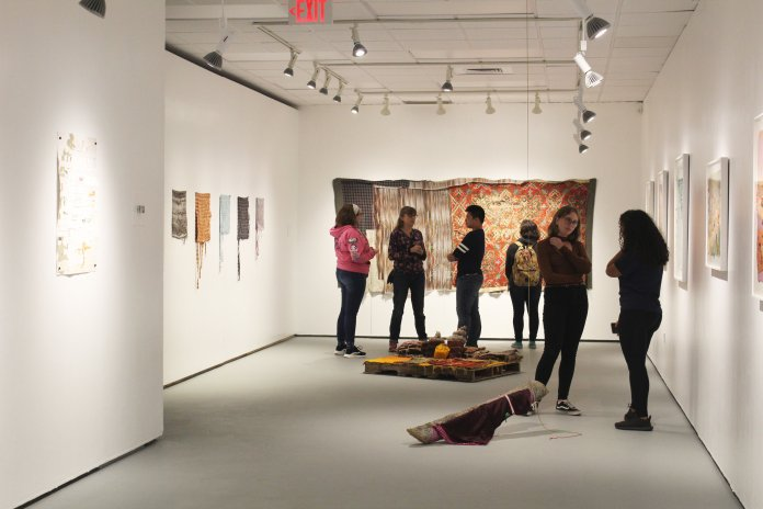 Elena Herzog's work on display in the UConn Art Building Monday. Herzog takes items that are often discarded for her fine art projects. (Emma Simard/The Daily Campus)
