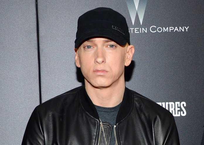 """FILE - In this July 20, 2015, file photo, rapper Eminem attends the premiere of """"Southpaw"""" in New York. Eminem released his new album """"Kamikaze"""" on Friday, Aug. 31, 2018. (Photo by Evan Agostini/Invision/AP, File)"""