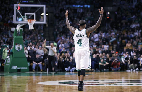Isaiah Thomas raises his arms as he celebrates after hitting a 3-pointer against the Charlotte Hornets during the second half of a game in Boston, Monday, Jan. 16, 2017. (Charles Krupa/AP)