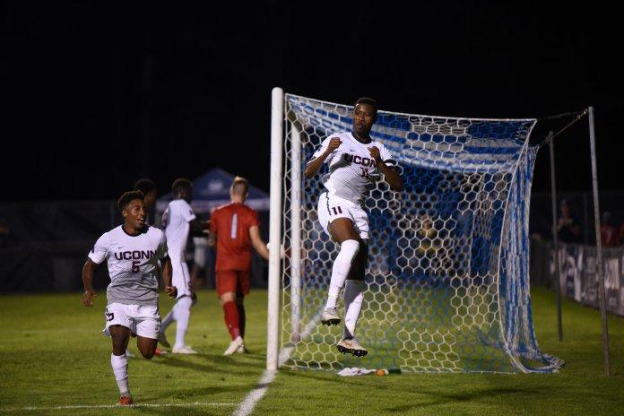 UConn's Abdou Mbacke Thiam strikes a pose by the net. (Charlotte Lao/ The Daily Campus)