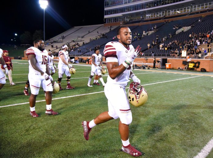 Boston College's AJ Dillon (2) leaves the field after rushing for 185 yards against Wake Forest during an NCAA college football game, Thursday, Sept. 13, 2018, in Winston-Salem, N.C. (AP Photo/Woody Marshall)