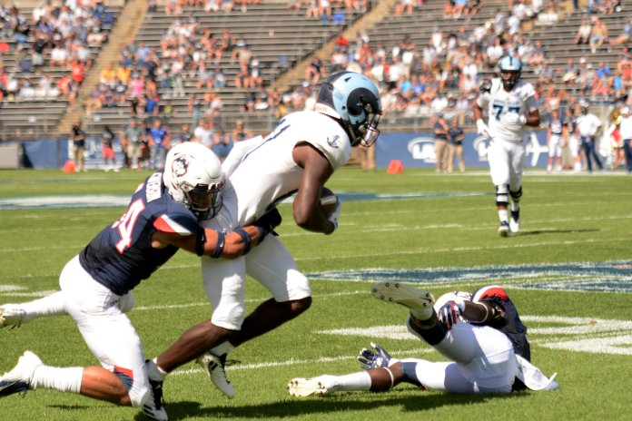The UConn Huskies won 56-49 to the URI Rams, lead by David Pindell with 308 passing yards and 265 rushing yards. They'll take on Syracuse on 9/22 next. (Eric Wang/The Daily Campus)