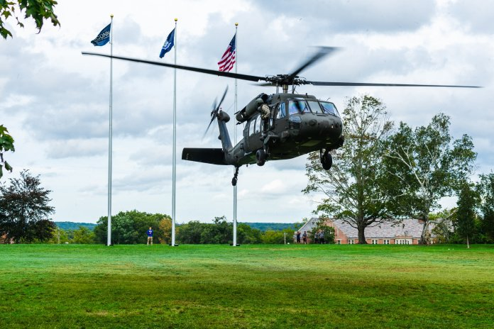 The Army National Guard helicopter takes off from the UConn memorial lawn Monday afternoon. The National Guard hosted Branch Day, a time for students to connect with officers and recruiters as well as win prizes. (Max Conley/The Daily Campus)