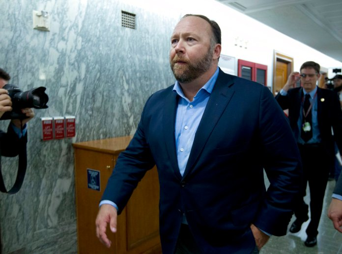 In this Wednesday, Sept. 5, 2018 file photo, Alex Jones, the right-wing conspiracy theorist, walks the corridors of Capitol Hill. (AP Photo/Jose Luis Magana, File)