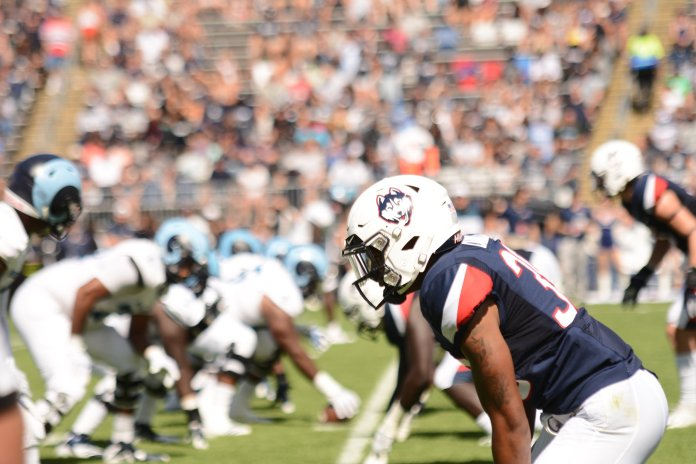 The UConn Huskies won 56-49 to the URI Rams, lead by David Pindell (5) with 308 passing yards and 265 rushing yards. They'll take on Syracuse on 9/22 next. (Photo by Eric Wang/The Daily Campus)