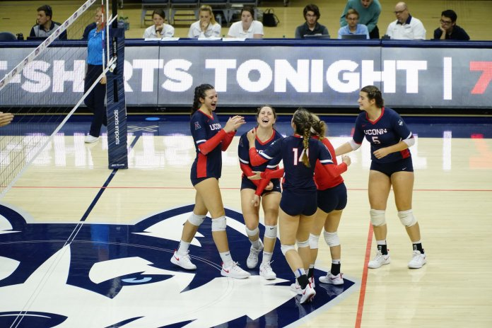 The UConn Huskies won 3-1 to Rutgers in this weekend's Dog Pound Challenge. Caylee Parker (22) led the team in kills while Elizabeth Kline (23) defended the team with 23 digs. Their next home game against ECU is on 10/5 at the Gampel Pavilion. (Photo by Eric Wang/The Daily Campus)