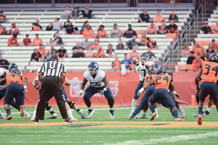 UConn quarterback Marvin Washington receives the snap during their game at Syracuse on Sept. 22, 2018. (Eric Wang/ The Daily Campus)