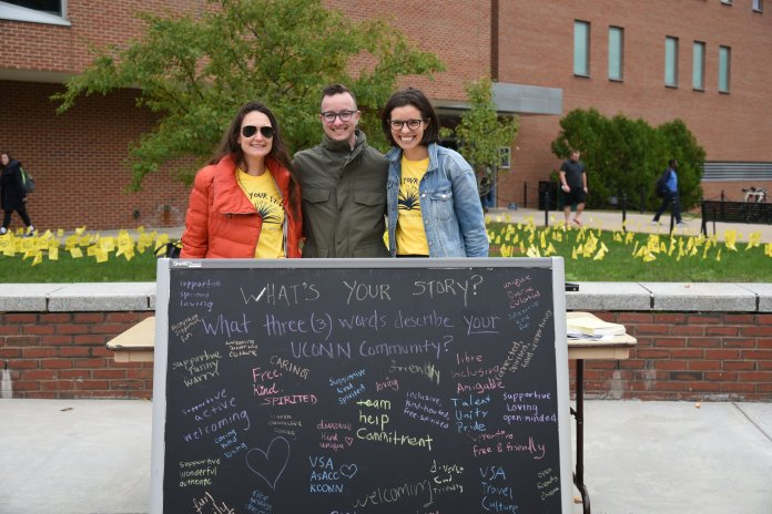 Suicide Prevention Week is happening throughout this week with lectures and activities. Today, people were able to write words of encouragement on yellow flags that are on display by Fairfield Way. Photo by Charlotte Lao/Photo Editor