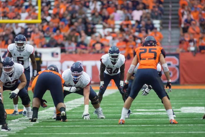 The UConn Huskies lost to Syracuse 51-21 this Saturday in the Carrier Dome. David Pindell (5) lead the team once again with 151 passing yards and 113 rushing yards. Their next home game is on 9/29 against Cincinnati. (Photo by Eric Wang/The Daily Campus)