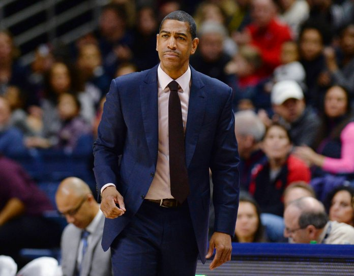 FILE - In this Feb. 25, 2018, file photo, then-Connecticut coach Kevin Ollie watches during the first half the team's NCAA college basketball game in Storrs, Conn. The University of Connecticut and former coach Ollie have been notified by the NCAA of alleged recruiting and other violations during his tenure at the school. The notice of allegations, released Friday night, Sept. 28, by UConn with the names of recruits redacted, includes numerous charges, including unethical conduct by Ollie for allegedly provided false or misleading information about video calls to a recruit from two former UConn stars, Hall of Famer Ray Allen and San Antonio Spurs guard Rudy Gay. (AP Photo/Jessica Hill, File)