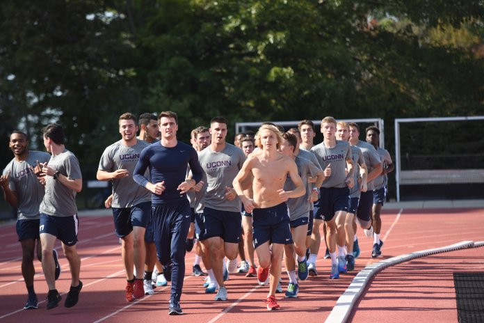 File- UConn men's cross country takes a lap around the George J Sherman Family Sports Complex. (Charlotte Lao/ The Daily Campus)