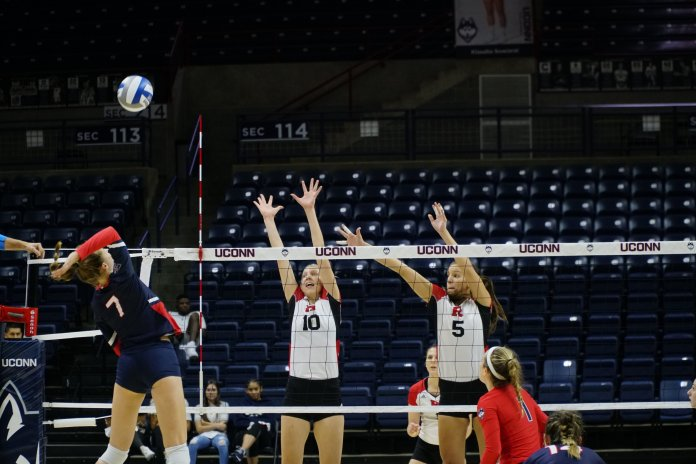 Anna Petrova rises above the competition during a match against Rutgers on Sept. 14, 2018. (Eric Wang/ The Daily Campus)