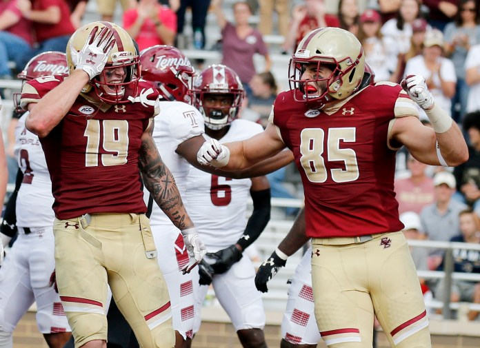 Boston College wide receiver Ben Glines (19) celebrates with teammate Korab Idrizi (85) after scoring a touchdown during a game against Temple on Saturday, Sept. 29 in Boston. (Mary Schwalm/AP)