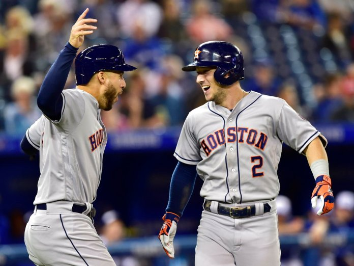 Houston Astros' Alex Bregman (2) celebrates his two-run home run with George Springer (4) during the first inning of a baseball game against the Toronto Blue Jays on Tuesday, Sept. 25, 2018, in Toronto. (Frank Gunn/The Canadian Press via AP)