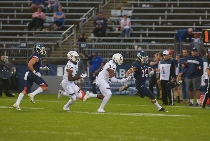 Zavier Scott (10) moves with the ball against Cincinnati (Nicholas Hampton/The Daily Campus)