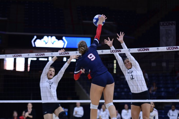 The UConn volleyball team brought on a new player for this weekend, working together with Team IMPACT to make it possible. (Eric Wang/The Daily Campus)